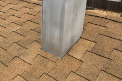 Incorrectly installed chimney chase flashing and T-Lock roof shingles, both are problems for different reasons